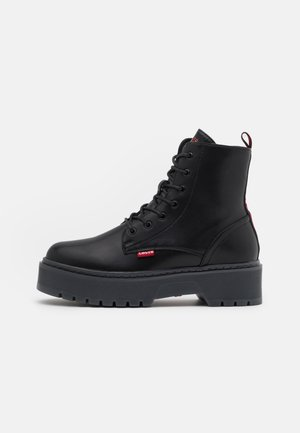 COOLIDGE MID ECO - Platform ankle boots - black