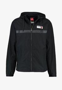 New Balance - ATHLETICS - Summer jacket - black - 4