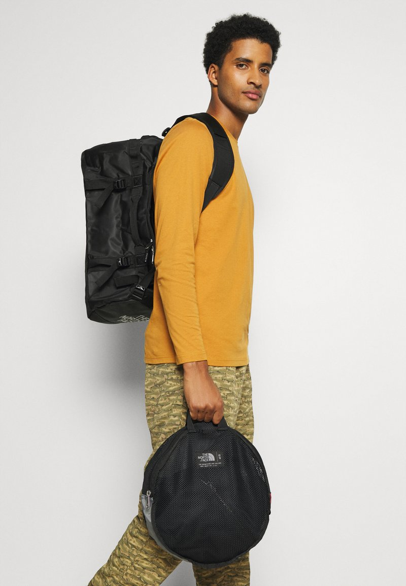 The North Face - BASE CAMP DUFFEL S UNISEX - Sports bag - black