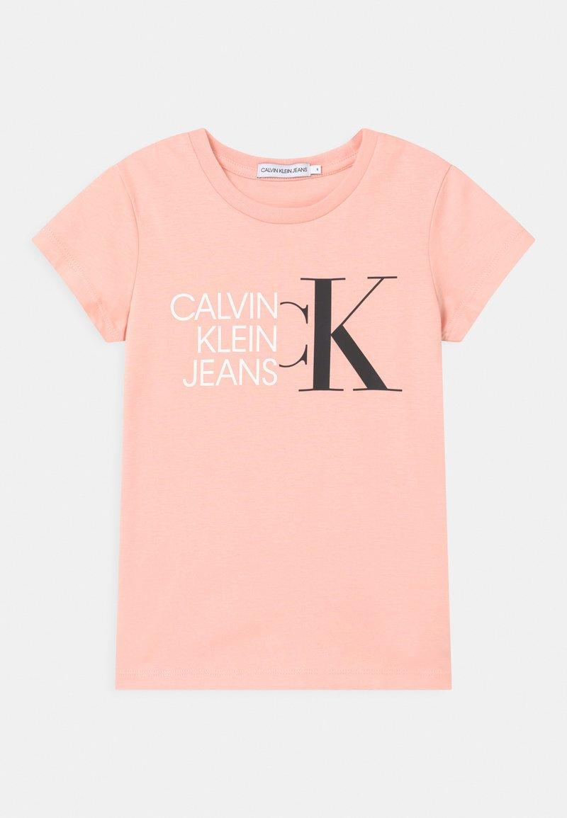 Calvin Klein Jeans - HYBRID LOGO SLIM - Triko spotiskem - pink