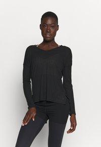 Nike Performance - POINTELLE - T-shirt sportiva - black/dark smoke grey - 0
