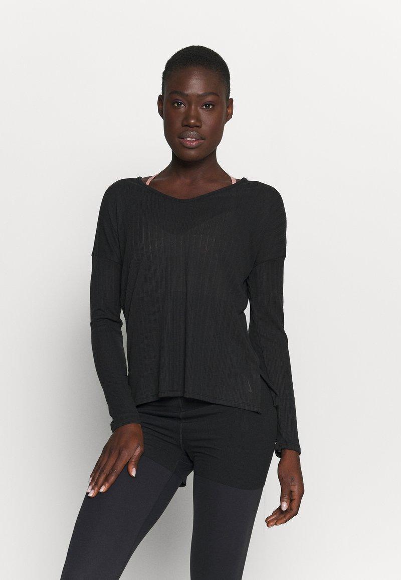 Nike Performance - POINTELLE - T-shirt sportiva - black/dark smoke grey