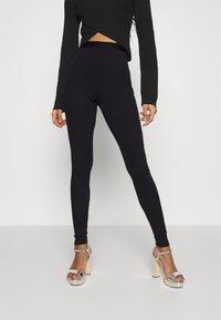NA-KD - ZIA - Leggings - Trousers - black - 0