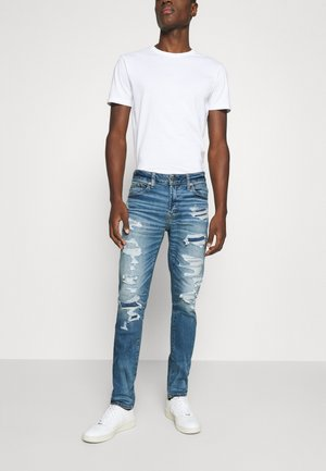 MEDIUM MENDED SKINNY - Slim fit jeans - medium destroy