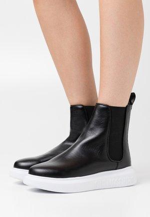 RUNNING - Platform ankle boots - black