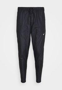 Nike Performance - SHIELD - Tracksuit bottoms - black/reflective silver - 6