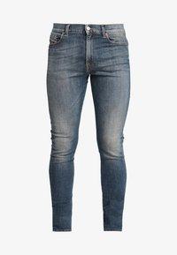 Diesel - D-AMNY-X - Slim fit jeans - blue denim - 4