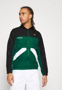 Lacoste Sport - TRACK JACKET - Training jacket - black/bottle green/white - 0