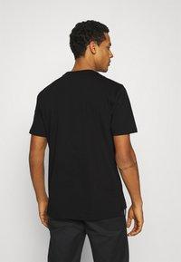 Diesel - T-JUST-SLITS-A30 MAGLIETTA UNISEX - Print T-shirt - black/black - 3