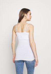 bellybutton - STILL ARM - Top - bright white - 2