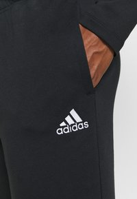 adidas Performance - ESSENTIALS TRAINING SPORTS PANTS - Tracksuit bottoms - black/white - 4