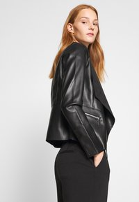 Dorothy Perkins - WATERFALL JACKET - Faux leather jacket - black - 4