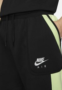 Nike Sportswear - AIR - Tracksuit bottoms - black/light liquid lime/white - 3