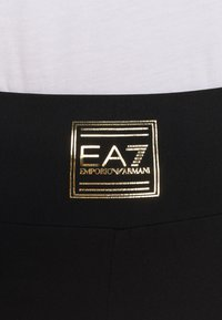 EA7 Emporio Armani - Leggings - Trousers - black - 5