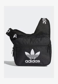 SLING BAG UNISEX - Across body bag - black/white