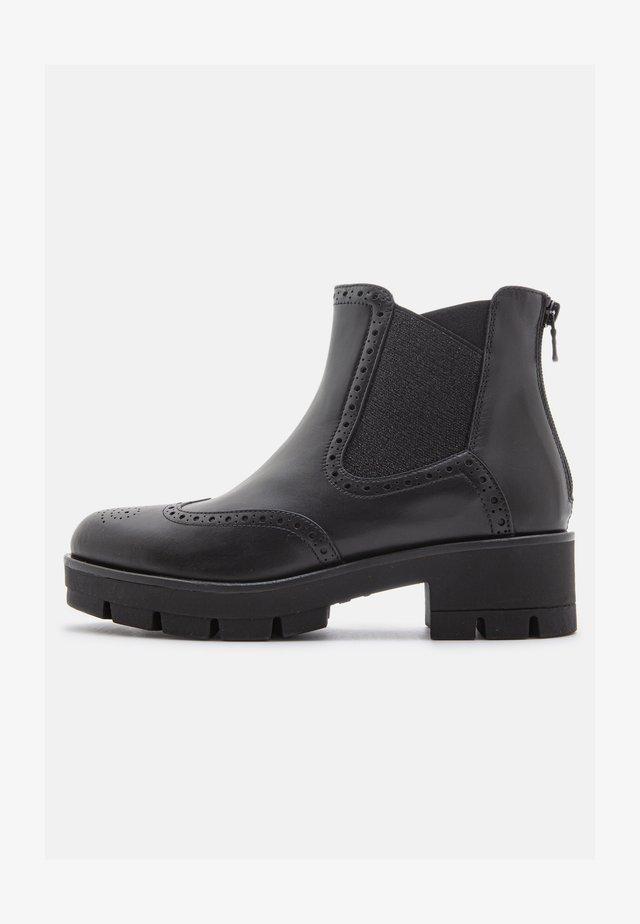 GUANTO SUASA  - Ankle boots - nero