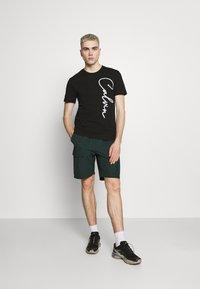Calvin Klein - SUMMER SCRIPT LOGO - T-shirt con stampa - black - 1
