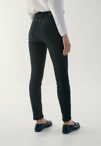 Massimo Dutti - HOHEM BUND - Jeans Skinny Fit - black - 2