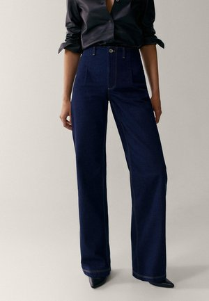 MIT BUNDFALTEN  - Flared Jeans - dark blue