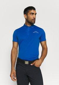 J.LINDEBERG - BRIDGE - Sports shirt - egyptian blue - 0