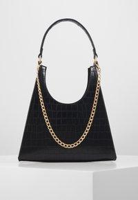 PCSTELLA CROSS BODY KEY - Handbag - black/gold