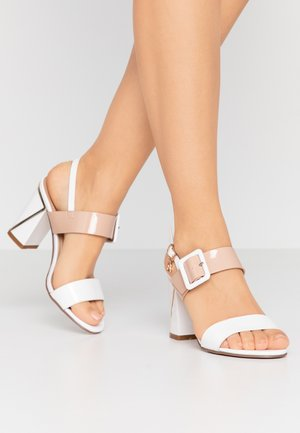 High heeled sandals - white/skin