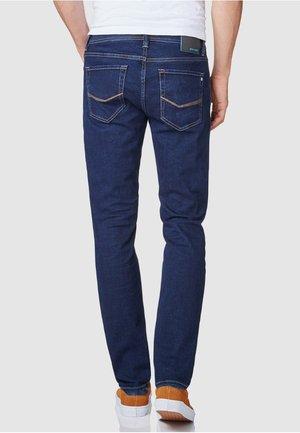 FLEX - Straight leg jeans - rinsed denim