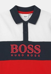 BOSS Kidswear - SHORT SLEEVE - Polo shirt - red/dark blue - 2