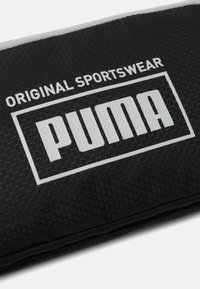 Puma - SOLE WAIST BAG UNISEX - Bum bag - black - 4