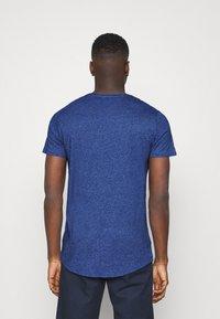 Tommy Jeans - SLIM JASPE V NECK - Jednoduché triko - blue - 2
