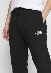 The North Face - JOGGER - Tracksuit bottoms - black - 4