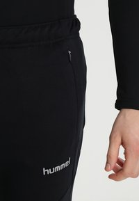 Hummel - TECH MOVE  - Tracksuit bottoms - black - 3
