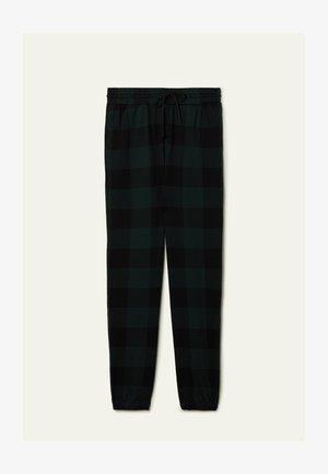Tracksuit bottoms - schwarz - black/pine green tartan check