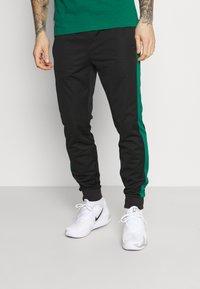 Lacoste Sport - TRACK PANT - Tracksuit bottoms - black/bottle green - 0