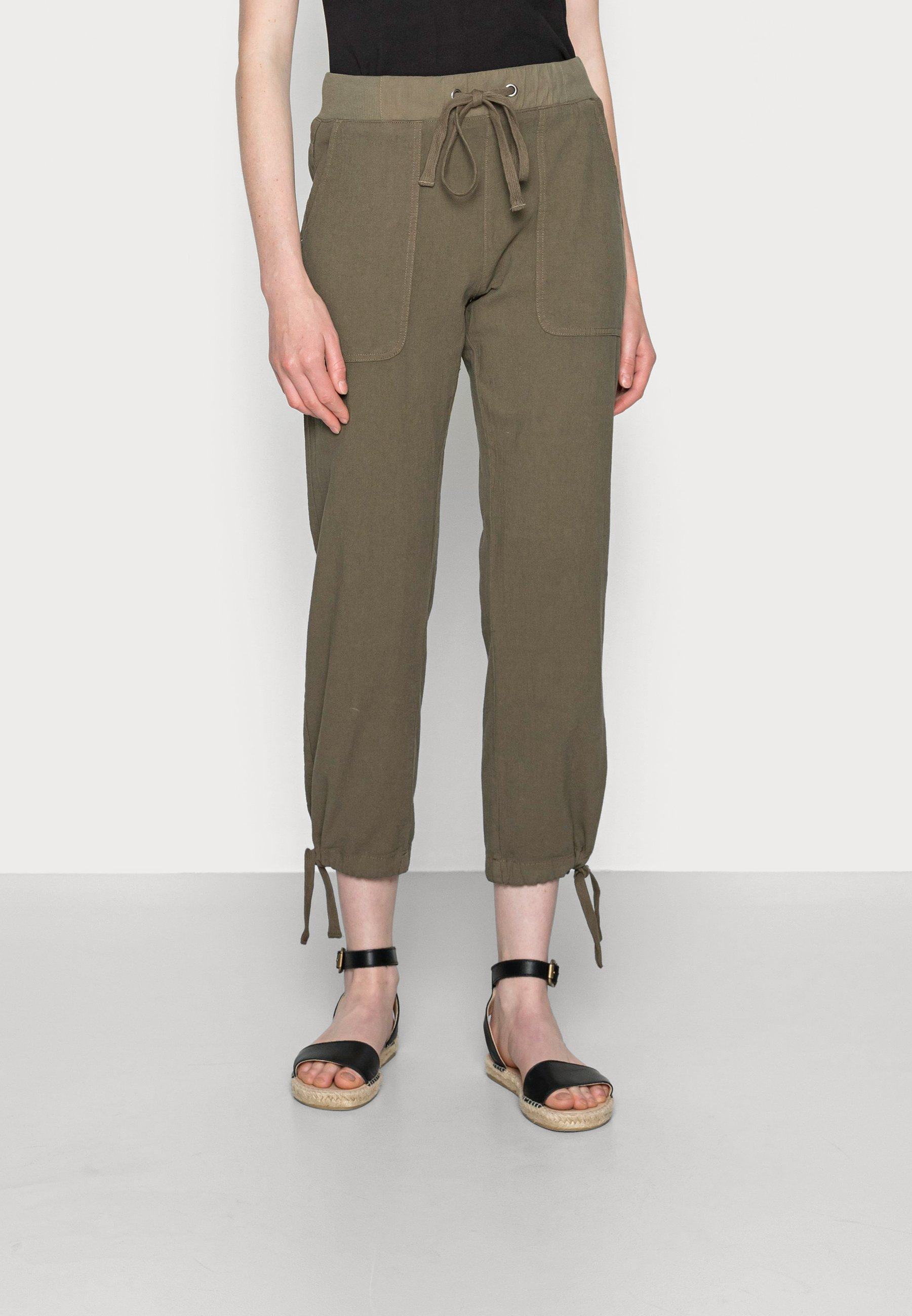 Damen NAYA STRING PANTS - Stoffhose