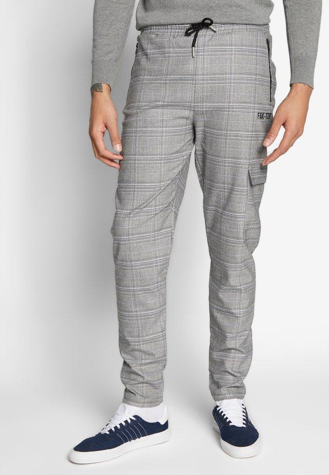 ANILIA TROUSER - Trousers - black
