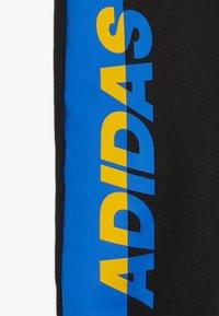 adidas Performance - PANT - Tracksuit bottoms - black/active gold/blue - 2