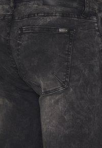Tigha - MORTY STONE WASH - Slim fit jeans - vintage black - 4