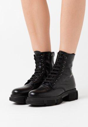 NASTA  - Kotníkové boty na platformě - nero