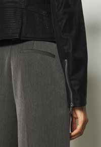 Guess - NEW KHLOE JACKET - Faux leather jacket - jet black - 6