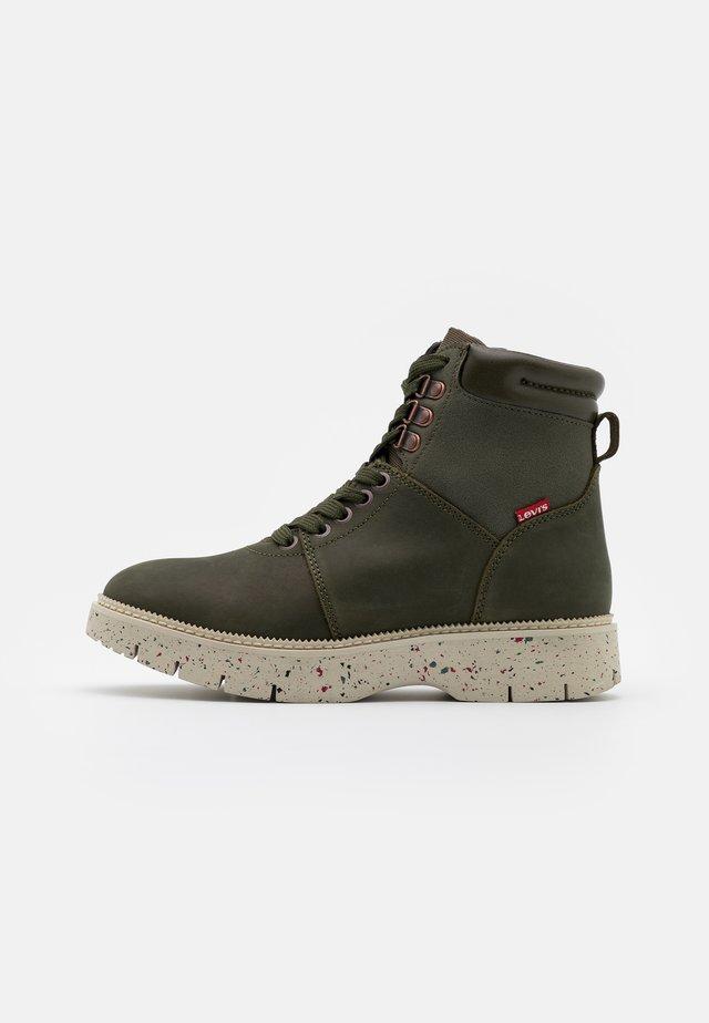 JAXY MID - Kotníkové boty na platformě - dark khaki