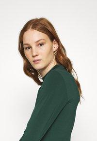 Even&Odd - Mini high neck long sleeves bodycon dress - Shift dress - dark green - 3
