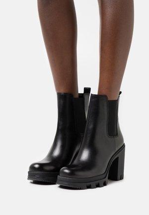 PONYE - Kotníkové boty - black