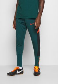 Nike Performance - PANT SOCK CUFF - Pantalon de survêtement - dark atomic teal/black/electro orange - 0