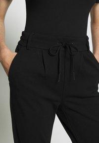 ONLY Petite - ONLPOPTRASH EASY COLOUR PANT - Trousers - black - 4
