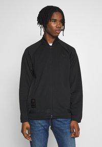 adidas Originals - WARMUP - Training jacket - black/goldmt - 0