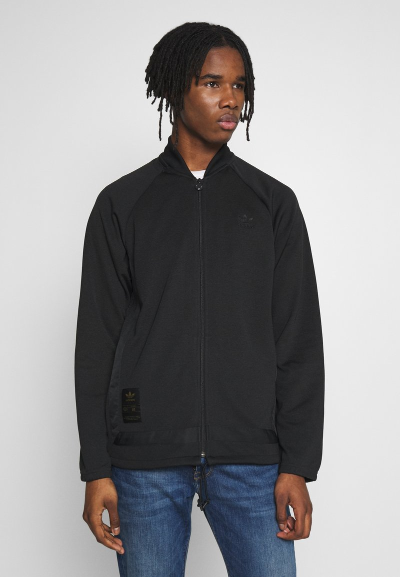 adidas Originals - WARMUP - Training jacket - black/goldmt