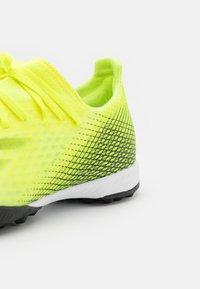 adidas Performance - X GHOSTED.3 TF - Kopačky na umělý trávník - solar yellow/core black/royal blue - 5