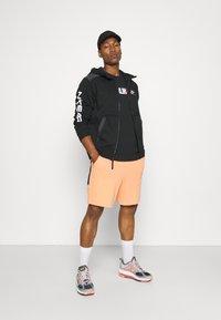 Nike Sportswear - WASH - Shorts - orange frost/black - 1