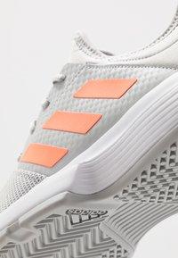 adidas Performance - GAMECOURT - Multicourt tennis shoes - grey two/signal orange/grey three - 5